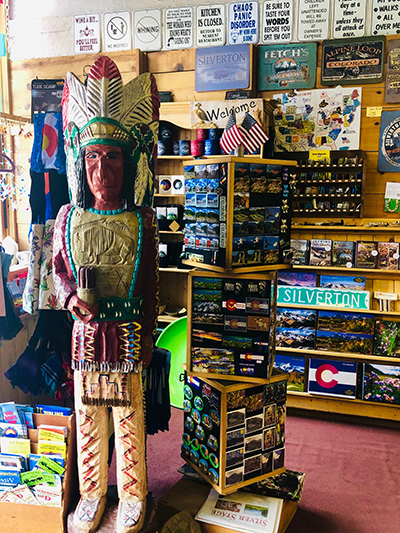 Wooden Indian greets shoppers at Fetch's.